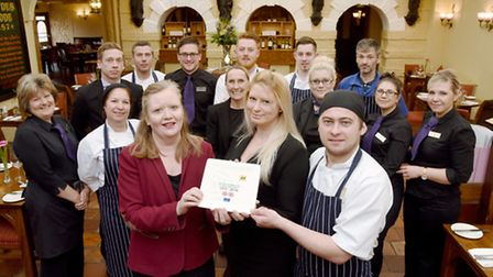 The Maids Head Hotel, Norwich has been awarded two AA rosettes for their food. Pictured holding the