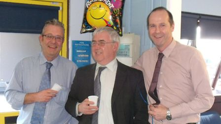 Roy Stringer, centre, who has retired from Hammond Motor Group after 40 years with, left, managing d