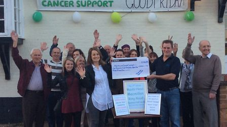 Easter Ring Road walkers presenting Macmillan with a cheque at the Maids Head pub