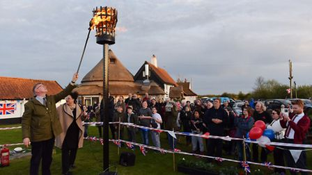 The lighting of the Queens beacon at Acle Bridge.Picture: James Bass