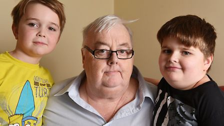 Bereaved brothers Jack Rayner (left) and Kallum Lynch (right) with their grandad Patrick Lynch.An ap
