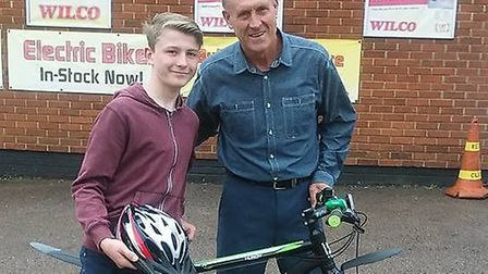 Farran Noble and Gary High with the bike donated by the Taylor High Memorial Fund. Picture: SUPPLIED