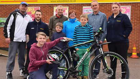 Gary High and staff from Wilco, Lowestoft donate a bike from the Taylor High memorial fund to Farran