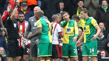 Andre Wisdom protests his innocence after conceding a first half penalty in Norwich City's 3-0 Premi