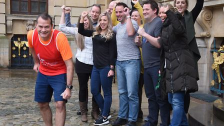 Steve Nichols is cheered on by his Aviva work colleagues, as he gets ready for the London marathon h
