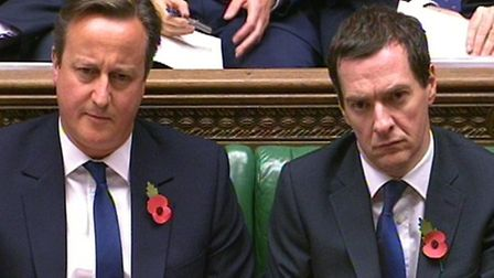 Prime Minister David Cameron and Chancellor George Osborne during Prime Minister's Questions in the
