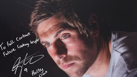 A signed photograph of Full Contact's client Grant Holt in their office. Picture: SUBMITTED