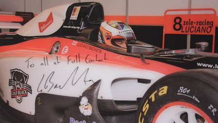 A signed photograph in their office of Full Contact's client, Formula Two World Champion Luciano Bac