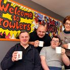 Bradley Gager (centre) with some of the group which designed the mural inside the cafe.The re-openin