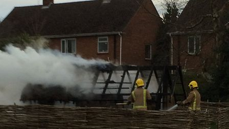 Firefighters putting out the fire that engulfed the Anglo-Saxon longhouse at West Earlham Junior Sch