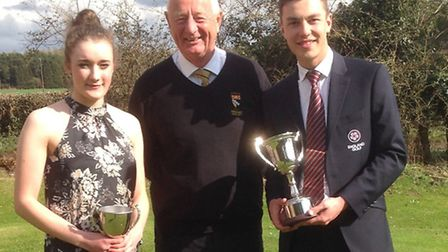 Champions Ellie Brown and Toby Briggs with Norfolk County Golf Union president Doug Gilchrist. Pict