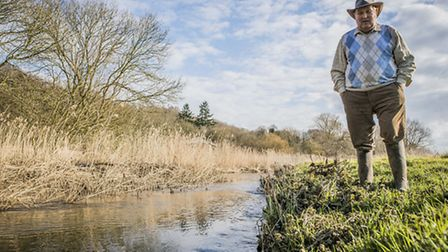 Cattle farmer Peter Howell by the River Wensum near North Elmham. Picture: Matthew Usher.