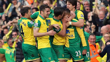 Martin Olsson is mobbed by his team mates as he celebrates his winning goal. Picture: Paul Chesterto
