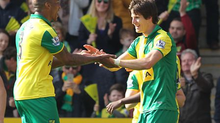 Timm Klose celebrates scoring his side's opening goal at Carrow Road. Picture by Paul Chesterton/Foc