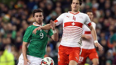Norwich City defender Timm Klose holds off the challenge of Republic of Ireland striker Shane Long w