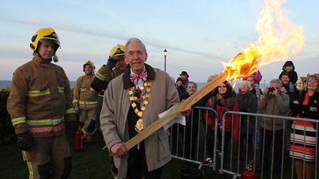 Sheringham mayor David Gooch with the torch used to light the beacon at the Leas clifftop gardens. P