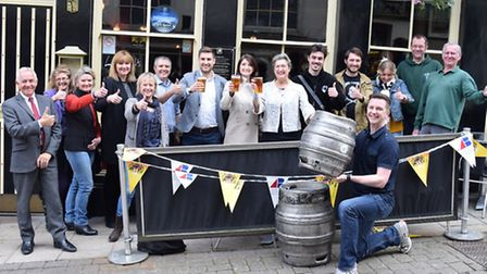 Charity ale competition winner Scott Edwards (holding barrel in foreground), Rob Browne and Rachael