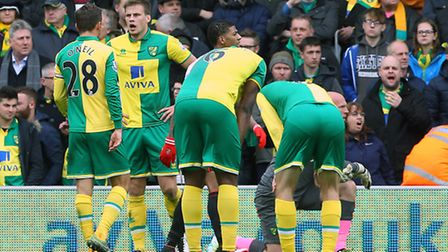 The Norwich City players look dejected as Duncan Watmore makes it 3-0 to Sunderland. Picture: Paul C