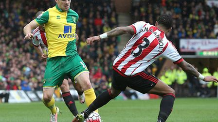 Robbie Brady of Norwich and Patrick van Aanholt of Sunderland in action during the Barclays Premier