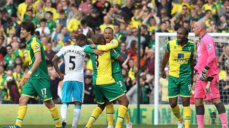 Winning goalscorer Martin Olsson of Norwich celebrates victory with Andre Wisdom of Norwich as Georg