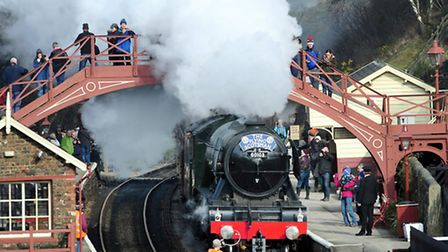 The Flying Scotsman steams through Goathland Station made famous in the Heartbeat TV series on its f