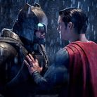 This image released by Warner Bros. Pictures shows Ben Affleck, left, and Henry Cavill in a scene fr