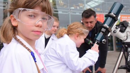 TV astronomer Mark Thompson is joined by children at the Forum for the launch of the Norwich Science
