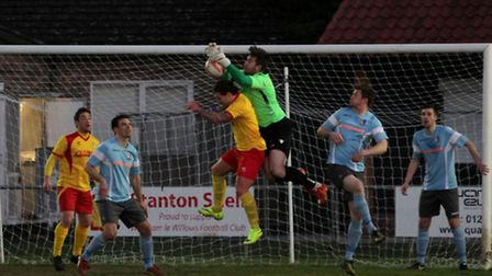 Norwich United keeper Jake Jessup makes a superb save in the Thurlow Nunn Premier Division, Norwich