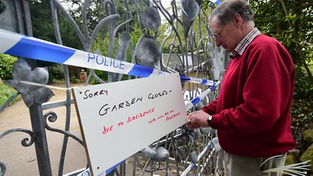 Roger Connah, chairman of Plantation Garden Preservation Trust puts up a closed sign.Picture: ANTONY