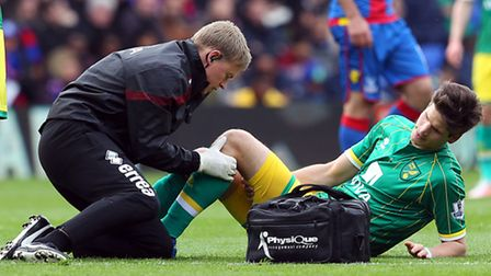 Timm Klose recieves treatment after picking up an injury at Crystal Palace - but could still be fit