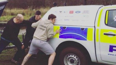A stag party helping Broads Beat officers push a truck and trailer out of mud. Picture: Norfolk Cons