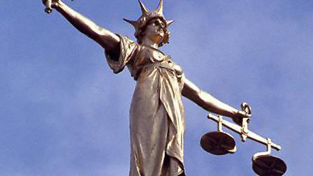 A Norwich boutique owner has appeared in court accused of harassment
