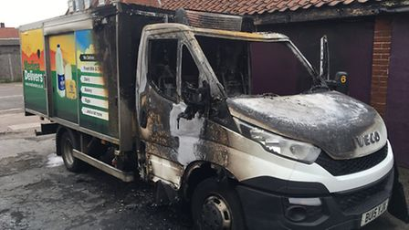 The destroyed milk delivery van, which was parked at the back of the Premier Express convenience sto
