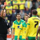 Referee Mark Brown sends off Norwich City's Lewis Grabban for an alleged punch on Rotherham's Craig