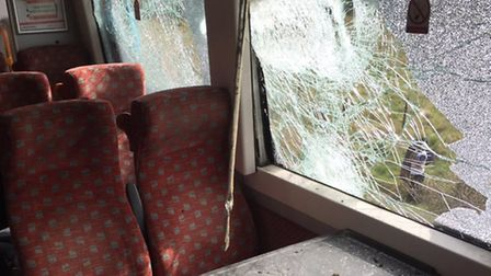 A carriage showing damage from the train crash at Roudham. Photo: Alex Youngs/Twitter