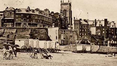 Wheeled bathing machines on the beach at the bottom of Cromer's Gangway in a scene that otherwise ha