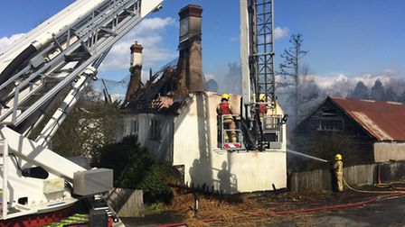Firefighters tackle a blaze at a thatched cottage in Oakley.