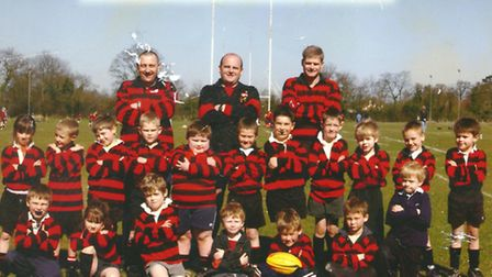 Leicester Tigers forward Will Evans, pictured second from right on the front row, with his Wymondham