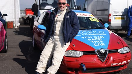 Paul Hollywood, from the Great British Bake Off, ready for the qualifying race for the Alfa Romeo Ch