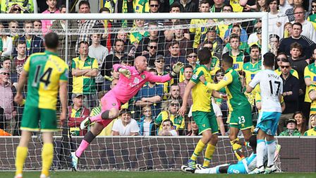 With the score at 2-2, Papiss Cisse of Newcastle United heads for goal but John Ruddy of Norwich lea