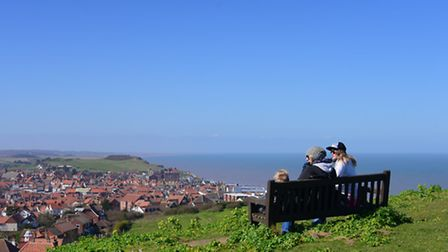 Looking from Beeston Hill people enjoy the weather in North Norfolk. PHOTO BY SIMON FINLAY