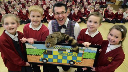 Olly Day giving a road safety roadshow to the children of North Walsham Manor Road Infants School. O