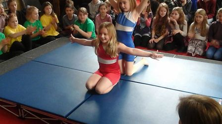 Jasmine Platten and Emily Bliss performing a gynmastics display.
