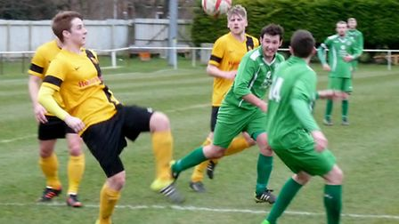 Gorleston (green) try to press during their 6-0 defeat at Mildenhall last weekend. Photo: DAVID HAR
