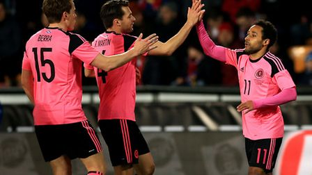 Scotland's Ikechi Anya celebrates scoring his side's first goal of the game with team-mates Christop