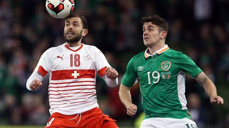 Republic of Ireland's Robbie Brady (right) and Switzerland's Admir Mehmedi battle for the ball durin
