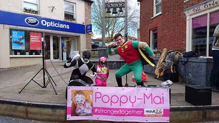Buskers raise funds for Poppy-Mai Barnard in Thetford town centre on Saturday.