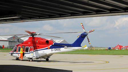 CHC ( foreground ) and Bond helicopter at Norwich Airport. Photo : Steve Adams
