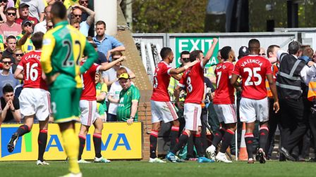 Juan Mata slots Manchester United's winner in a 1-0 Premier League victory at Norwich City. Picture