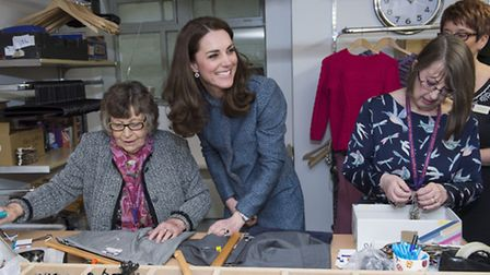 The Duchess of Cambridge talks to volunteers during a visit to open a new charity shop for East Angl